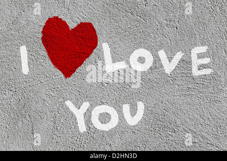Inscription 'I love you' with abstract heart on the wall - Stock Photo