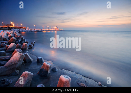 Beautiful winter evening on a frozen beach in Hel Peninsula, Polish Baltic coast. - Stock Photo