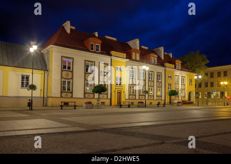 Old historic houses at night in Bialystok, Poland. - Stock Photo