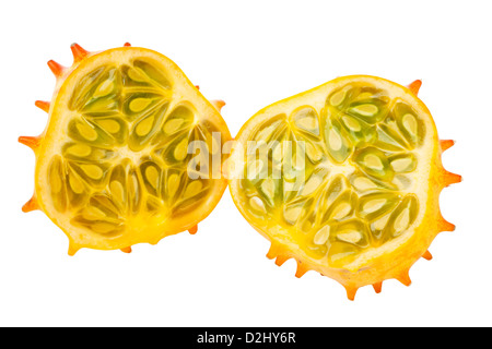 Halved Kiwano fruit, also called African Horned melon or Horned Cucumber, isolated on white background - Stock Photo