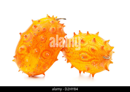 Two Kiwano fruit, also called African Horned melon or Horned Cucumber, isolated on white background - Stock Photo