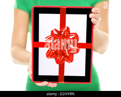 Mid section of young mixed race woman showing and giving digital tablet computer as present isolated on white background - Stock Photo