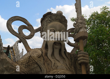 Close up of statue of guard, Built in Stone, Situated at Reclining Buddha Temple Complex, Bangkok, Thailand - Stock Photo