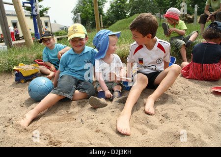 Saarbruecken, Germany, children playing in the sand of a Kindertagesstaette - Stock Photo