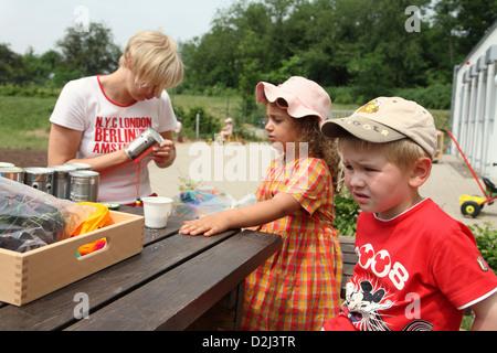 Saarbruecken, Germany, tinkering with children in a kindergarten teacher Kindertagesstaette - Stock Photo