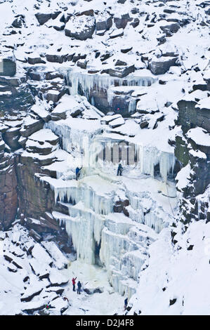 English Peak District, UK. 25th January 2013.  Ice climbers climbing a frozen waterfall ,Kinder Downfall on Kinder - Stock Photo