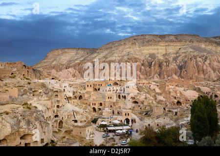 Redevelopment of ancient stone dwellings in hilltop village of Cavusin in Cappadocia Turkey - Stock Photo