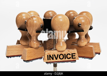 Many stamps hanging in a stamp rack. One stamp with the inscription invoice hangs in front, background white. - Stock Photo