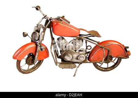 Old retro toy motorbike isolated on a white background - Stock Photo