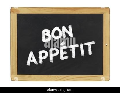 bon appetit on a blackboard - Stock Photo