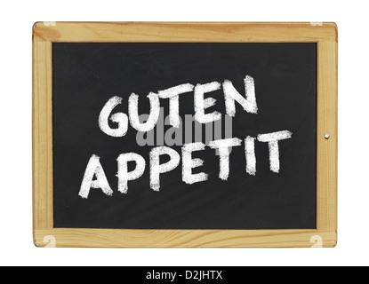 Guten Appetit on a blackboard - Stock Photo