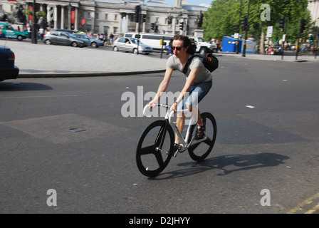 cyclist on Trafalgar Square London United Kingdom - Stock Photo