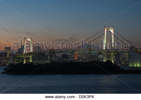 Tokyo city skyline and the Rainbow Bridge from Odaiba Tokyo Japan - Stock Photo