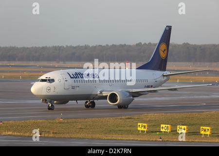 Berlin, Germany, Lufthansa airplane on a runway at Berlin-Tegel Airport - Stock Photo
