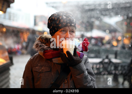 London, United Kingdom, woman drinking coffee from a paper cup - Stock Photo