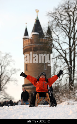 Potsdam, Germany, boy on his sled before the Flatow Tower in Babelsberg Park - Stock Photo