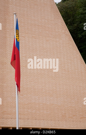 Vaduz, Liechtenstein national flag in front of the Parliament of the Principality of Liechtenstein - Stock Photo