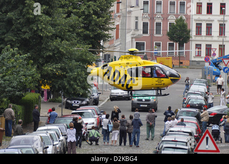 Leipzig, Germany, ADAC rescue helicopter Christoph 61 starts from a small crossroads - Stock Photo