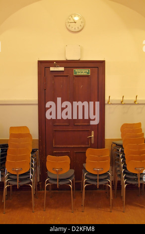 Hamburg, Germany, stacked chairs in front of an emergency exit in the hallway of the Laeiszhalle - Stock Photo