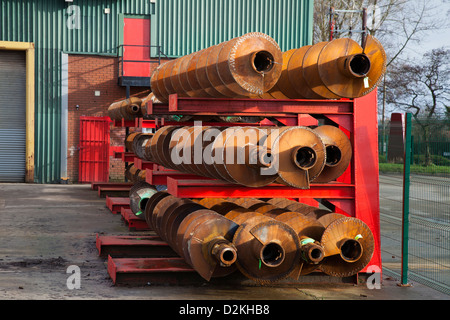 Rusty used augers on racks; Geotechnical drilling equipment Specialists _ Bachy Soletanche Ltd in Burscough, Lancashire, - Stock Photo