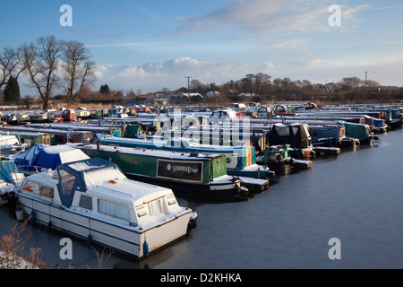 Fettlers Wharf Marina, in winter after snow on the Rufford branch of the Leeds Liverpool Canal, Ormskirk, Lancashire, - Stock Photo