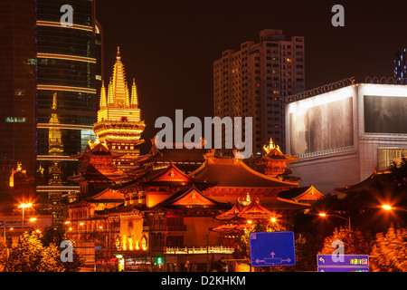 Golden Temples Roof Top Jing An Tranquility Temple Central Shanghai, China. Richest Buddhist temple in Shanghai - Stock Photo