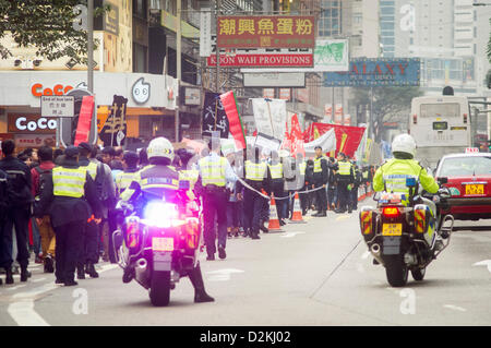 People gather for march to protest against the city leader on Sunday, 27 Jan 2013. Hong Kong, China. - Stock Photo