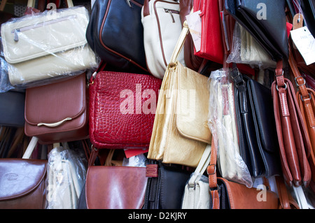 Leather handbags for sale to tourists in limone - Stock Photo