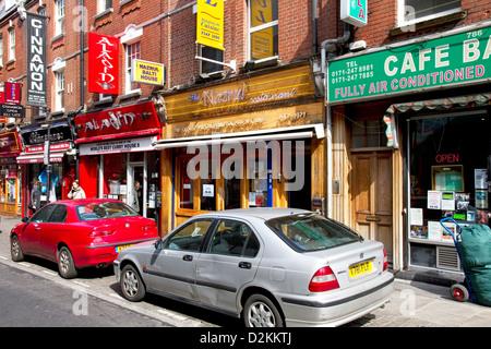 Restaurants on Brick Lane, Spitalfields, Tower Hamlets, East End, London, UK - Stock Photo