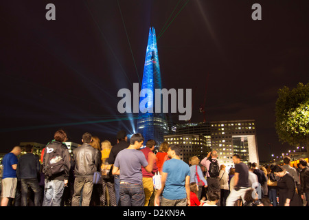 Crowds Watching Inaugural laser light Show - The Shard Skyscraper - London - Stock Photo