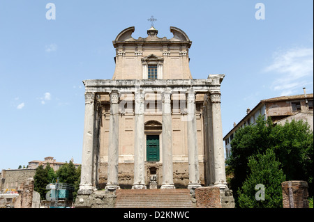 the monolithic Corinthian column pronaos and flight of steps of the Temple of Antoninus and Faustina in the Roman - Stock Photo