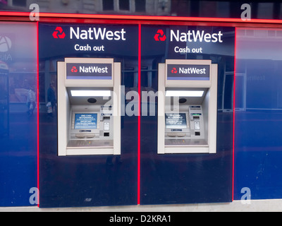 Two Cash Machine ATM Hole in the Wall Automatic Teller Natwest Bank - Stock Photo
