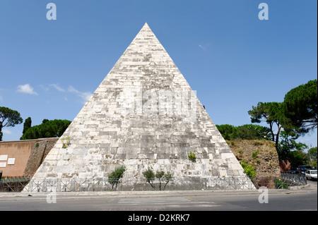 Rome. Italy. View of the Egyptian like landmark Pyramid of Caius Cestius in the Rome neighbourhood of Testaccio. - Stock Photo