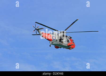 A Royal Navy rescue Sea King helicopter in flight. - Stock Photo