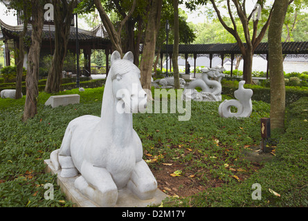 Chinese Zodiac statues in Kowloon Walled City, Kowloon, Hong Kong, China - Stock Photo