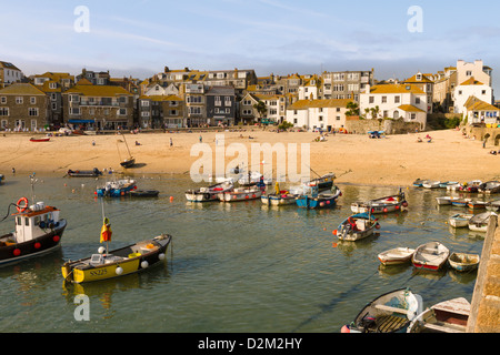 View of St Ives harbour and beach with fishing boats on the sand at low tide, Cornwall, England - Stock Photo