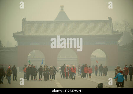 Tourists visit the Temple of Heaven at dangerous levels of air pollution in Beijing, China.  28-Jan-2013 - Stock Photo