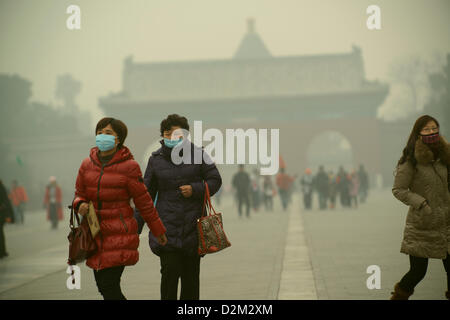 Tourists wearing the masks visit the Temple of Heaven at dangerous levels of air pollution in Beijing, China.  28 - Stock Photo