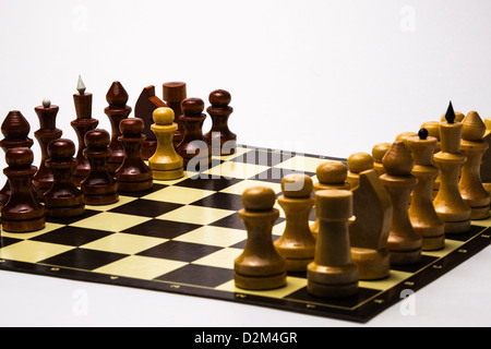 Our man in Havana. A white pawn in a set of black chess pieces on a chessboard. Isolated, white background. - Stock Photo