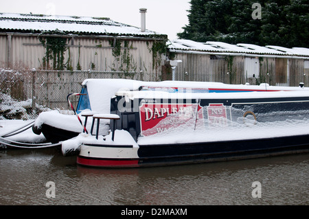 Narrowboats on Grand Union Canal in winter - Stock Photo
