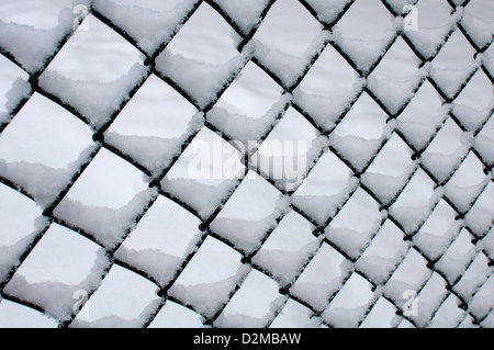 Chain-link fencing with snow on - Stock Photo