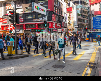 Street scene in Hong Kong - in the Causeway Bay area crowded with people on the streets - Stock Photo
