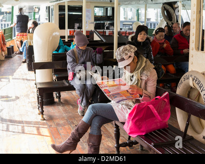 Passengers on the Star Ferry, Hong Kong - Stock Photo