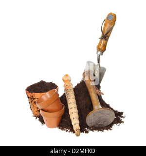 Garden tools and terracotta pots with a heap of soil isolated against white - Stock Photo