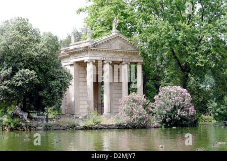 Rome. Italy. The Ionic Temple of Aesculapius in the lake garden (Giardino dei Lago) at the Villa Borghese Gardens - Stock Photo