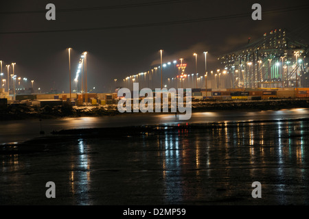 Night photograph of the Southampton Container Port, Southampton Water, Southampton, Hampshire, England, UK. - Stock Photo