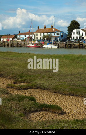 Looking across the River Blyth towards houses and moored yachts on the Southwold bank; Walberswick, Suffolk, England - Stock Photo