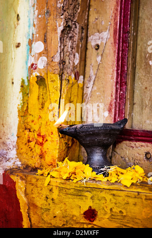 Burning indian oil lamp on the doorstep of a rural indian village house at Diwali festival. India - Stock Photo