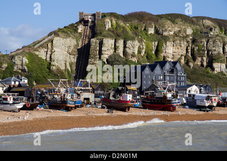 Fishing fleet drawn up on beach and East Hill lift, Hastings, Sussex, England, United Kingdom, Europe - Stock Photo