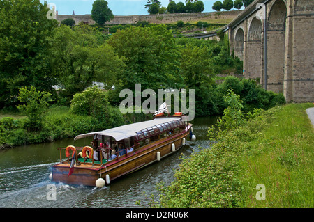 Tourists boat on river Rance, and river banks, with aqueduct, and castle walls, Dinan, Brittany, France, Europe - Stock Photo